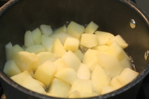 Apples and pears cooking on the stove for 6-7 minutes or until fork tender.