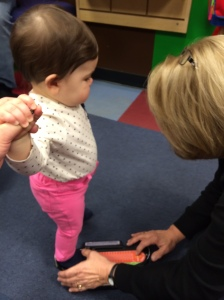 Mattelyn getting sized at Stride Rite for her first shoe fitting.