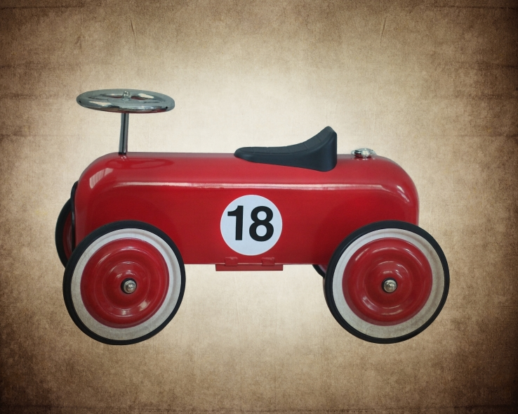 Vintage Metal Toy Pedal Car Replica.